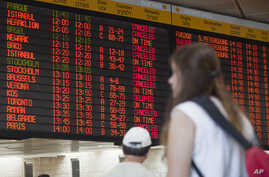 A departure flight board displays various canceled and delayed flights in Ben Gurion International airport a day after the U.S. Federal Aviation Administration imposed a 24-hour restriction on flights to the airport in Tel Aviv, Israel, July 23, 2014