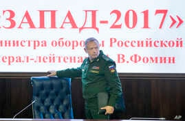Deputy Defense Minister Lt. Gen. Alexander Fomin arrives for a briefing in Moscow, Russia, Aug. 29, 2017. The Russian military says major war games, the Zapad (West) 2017 maneuvers, set for next month will not threaten anyone.
