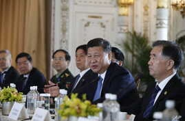 Chinese President Xi Jinping speaks during a bilateral meeting with President Donald Trump at Mar-a-Lago, April 7, 2017, in Palm Beach, Fla.