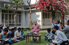 Bangladesh Bank Governor Atiur Rahman, center, addresses a press conference in Dhaka, Bangladesh, Tuesday, March 15, 2016.
