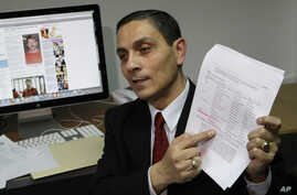 FILE - Richard Chichakli talks to a reporter in Moscow after being accused of offenses linked to alleged arms trafficking, Feb. 19, 2010.