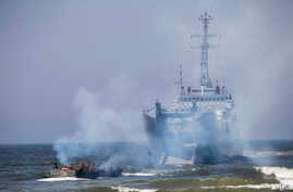 Poland's navy ships and U.S. marines take a part in a landing operation during military Exercise Baltops 2018 at the Baltic Sea near village Nemirseta in Klaipeda district, some 340 kms (211 miles) west north of the capital Vilnius, Lithuania. Lithua
