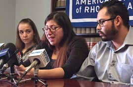 FILE - Lilian Calderon, center, cries as she describes her experiences while in custody, alongside her husband, Luis Gordillo, right, during a news conference at the office of the American Civil Liberties Union in Providence, R.I., Feb. 14, 2018. Cal