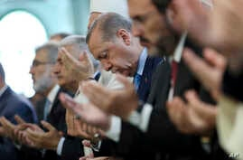 FILE - Turkey's President Recep Tayyip Erdogan, offers his prayers, during a prayer for the victims of the July 15, 2016, failed coup attempt, at the mosque of the Presidential Palace in Ankara, Turkey, July 14, 2017.