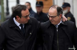 Catalan politicians Josep Rull (L) and Jordi Turull arrive together to the Supreme Court after being summoned and facing investigation for their part in Catalonia's bid for independence in Madrid, Spain, March 23, 2018.