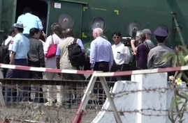 In this image made from video, U.N. Security Council ambassadors board a helicopter to fly to Maungdaw district of Rakhine State, in Sittwe, Myanmar, Tuesday, May 1, 2018.