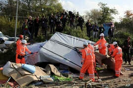 """Crews start to demolish shelters in the makeshift migrant camp known as """"the jungle"""" near Calais, northern France, Oct. 25, 2016."""