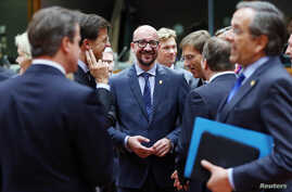 Belgian Prime Minister Charles Michel, center, stands among EU leaders at his first European Union summit in Brussels, Oct. 23, 2014.