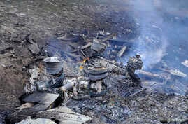 The wreckage of the Boeing KC-135 Stratotanker plane is seen at the site of the crash near the Kyrgyz village of Chaldovar, May 3, 2013.