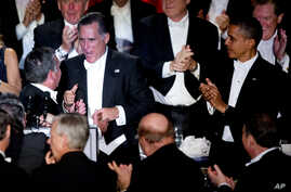 President Barack Obama and Republican presidential candidate Mitt Romney attend at the Archdiocese of New York's 67th Annual Alfred. E. Smith Memorial Foundation Dinner at the Waldorf Astoria Hotel in New York, October 18, 2012.