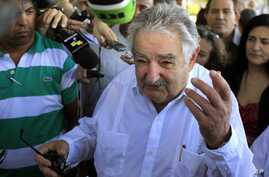 Uruguay's President Jose Mujica speaks to journalists after laying flowers at a monument of his nation's hero Jose Gervasio Artigas Arnal in Havana, Cuba, July 25, 2013.