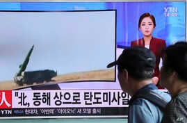 People watch a TV news program reporting about North Korea's missile launch, at the Seoul Train Station in Seoul, South Korea, Sept. 5, 2016.