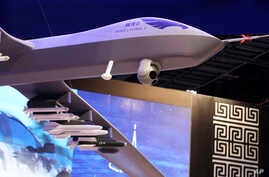 FILE -A model of the Wing Loong II weaponized drone for the China National Aero-Technology Import & Export Corp. is displayed at a military drone conference in Abu Dhabi, United Arab Emirates, Feb. 25, 2018.
