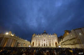 Faithful wait for the result of the first vote during a papal election conclave at St Peter's square at the Vatican, March 12, 2013.