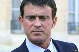 FILE - In this Oct. 23, 2013 file photo French Interior Minister, Manuel Valls pauses as he speaks to the media at the Elysee Palace in Paris