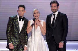 """Anthony Ramos, from left, Lady Gaga and Bradley Cooper, nominated for outstanding performance by a cast in a motion picture, introduce a clip from their film """"A Star Is Born"""" at the 25th annual Screen Actors Guild Awards at the Shrine Auditorium & Ex"""