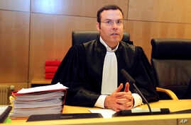 Criminal court President Nicolas Leger chairs the Rennes courtroom, western France, Monday, March 16, 2015.