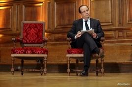 French President Francois Hollande attends conference at the Sorbonne, Paris, Feb. 21, 2013.