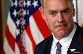 Ryan Zinke pauses after he was sworn in to be Secretary of the Interior in Washington, March 1, 2017.