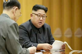 FILE - This image made from undated video of a news bulletin aired by North Korea's KRT on Sept. 3, 2017, North Korea's leader Kim Jong Un holds the Presidium of the Political Bureau of the Central Committee.