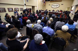 Ferguson residents pack the council chambers for a meeting of the City Council, Feb. 2, 2016, in Ferguson, Mo.