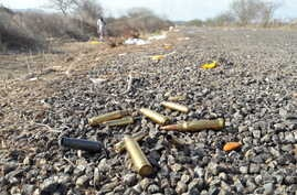 Spent bullet casing litter a road after authorities reported a gun battle with armed men near the beach resort of Mazatlan, Mexico, July 1, 2017. Mexican authorities said at least 19 people died in clashes involving armed men and security forces.