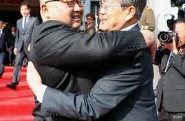 North Korean leader Kim Jong Un, left, and South Korean President Moon Jae-in embrace at a meeting May 26, 2018, north of the DMZ in this photo released by Moon's spokesperson.