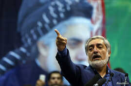 FILE - Afghan presidential candidate Abdullah Abdullah gestures during a gathering of his supporters in Kabul, July 8, 2014.