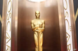 FILE - An Oscar statue is on display in Los Angeles, March 2, 2104.