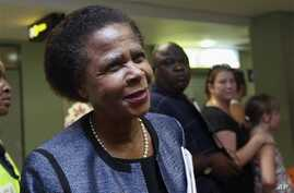 Former South African anti-apartheid activist Mamphela Ramphele speaks to reporters at the East London airport in Eastern Cape, South Africa, after arriving to attend the late former South African President Nelson Mandela's funeral, Saturday, December