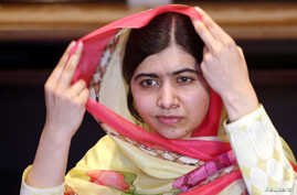 Nobel Peace Prize laureate Malala Yousafzai adjusts her scarf as she speaks during an interview with Reuters at a local hotel in Islamabad, Pakistan, March 30, 2018.