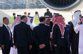 Saudi Arabia's King Salman, center, is greeted by Jordan's King Abdullah II and others, on the tarmac at a military airport on the outskirts of the capital, Amman. Monday, March 27, 2017.