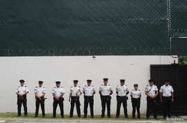 Guatemalan police officers stand outside the International Commission Against Impunity in Guatemala (CICIG) headquarters in Guatemala City, Guatemala, Aug, 28, 2017.