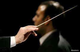 FILE - A conductor conducts an orchestra, Jan. 3, 2007.
