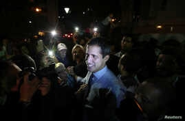 Venezuelan opposition leader Juan Guaido, who many nations have recognized as the country's rightful interim ruler, talks to the media at a news conference in Caracas, Venezuela, April 2, 2019.