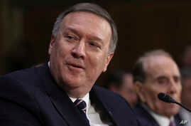 FILE - CIA Director-designate Rep. Michael Pompeo, R-Kan, accompanied by former Senate Majority Leader Bob Dole, testifies on Capitol Hill in Washington, Jan. 12, 2017, at his confirmation hearing before the Senate Intelligence Committee.