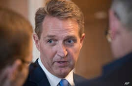 Sen. Jeff Flake, R-Ariz., takes questions from reporters at the Capitol in Washington, Jan. 4, 2018.
