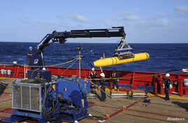 FILE - The Bluefin 21, the Artemis autonomous underwater vehicle (AUV), is hoisted back on board the Australian Defense Vessel Ocean Shield after a successful buoyancy test in the southern Indian Ocean as part of the continuing search for the missing