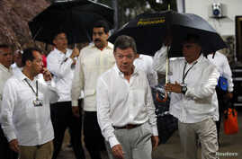 Colombian President Juan Manuel Santos, seen here in Puerto Ayacucho July 22, 2013, is in talks to end five decades of conflict with the Revolutionary Armed Forces of Colombia (FARC).