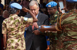 United Nations Secretary-General Antonio Guterres, 2nd left, gives a medal to a U.N. soldier during the ceremony of Peacekeepers' Day at the operating base of MINUSMA (The United Nations Multidimensional Integrated Stabilization Mission in Mali) in B