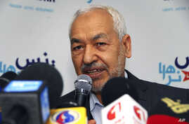 The leader of the Islamist Ennahda Party, Rached Ghannouchi, delivers a statement in Tunis, Monday, March 26, 2012. Islamic law will not be enshrined in Tunisia's new constitution, preserving the secular basis of the North African nation, Tunisia's r