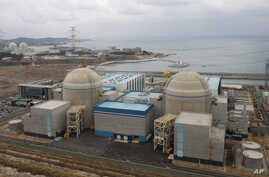 FILE - Shin-Kori No. 2 nuclear power plant, left in foreground, stands next to Shin-Kori No. 1 plant, right foreground, in Ulsan, South Korea.