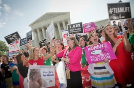 Demonstrator react to hearing the Supreme Court's decision on the Hobby Lobby case outside the Supreme Court in Washington, June 30, 2014.