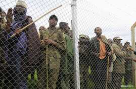 Congolese M23 rebel fighters gather inside an enclosure after surrendering to Uganda's government at Rugwerero village in Kisoro district, 489km (293 miles) west from Uganda capital Kampala, Nov. 8, 2013.