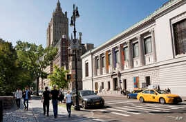 FILE - The New-York Historical Society, at right, is next to an entrance to the city's Central Park.