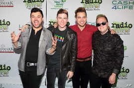 FILE - Eli Maiman, from left, Nicholas Petricca, Kevin Ray and Sean Waugaman of the band Walk the Moon pose for photographers.