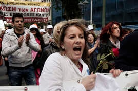 Medical staff take part in a protest rally against austerity measures in Athens, Greece, April 17, 2013.
