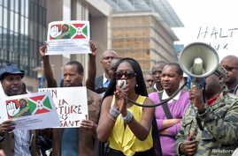 FILE - Singer Khadja Nin (C) takes part in a protest against Burundi President Pierre Nkurunziza and his bid for a third term, in Brussels, Belgium, May 23, 2015.