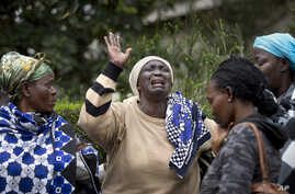Mary Italo, center, grieves with other relatives for her son Thomas Abayo Italo, 33, who was killed in the Westgate Mall attack, as they wait to receive his body at the mortuary in Nairobi, Kenya Wednesday, Sept. 25, 2013. Thomas was an accountant an