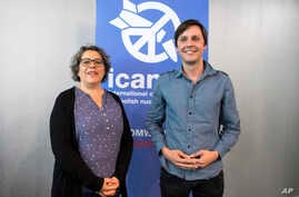 Sascha Hach, right, and Xanthe Hall of the International Campaign to Abolish Nuclear Weapons  ICAN  Germany, pose in their office in Berlin, Oct. 6, 2017.